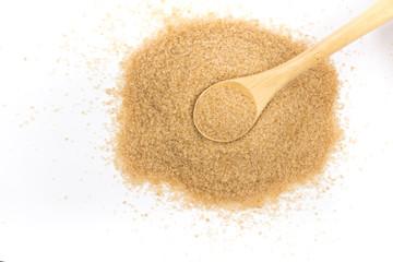 Pile of demerara sugar in a spoon. Top view