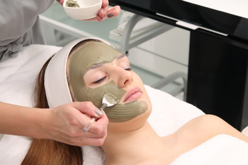 facial treatment of young woman