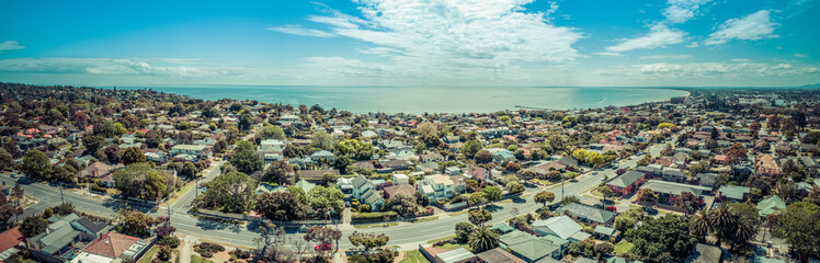 Aerial panorama of Frankston suburb and Mornington Peninsula coastline on hot sunny day