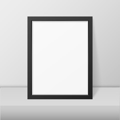 Vector 3d Realistic Modern Interior Black Blank Vertical A4 Wooden Poster Picture Frame on Table or Shelf Closeup on White Wall, Mock-up. Empty Poster Frame Design Template for Mockup, Presentation
