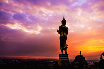 """Great Golden Buddha statue at the""""Wat Phra That Kao Noi"""" , Nan province, Thailand  with sky  Twilight time"""
