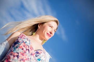 Outdoor beautiful happy woman low angle shot