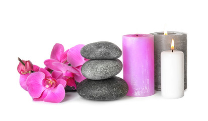 Composition with spa stones and candles on white background