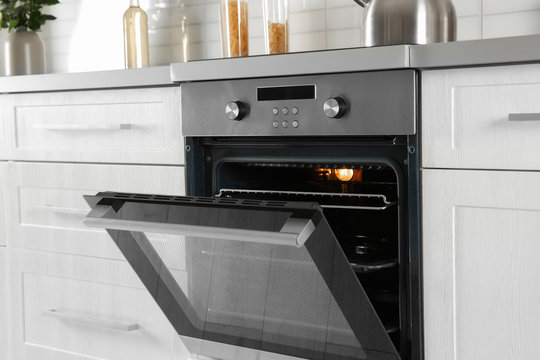 Open modern oven built in kitchen furniture
