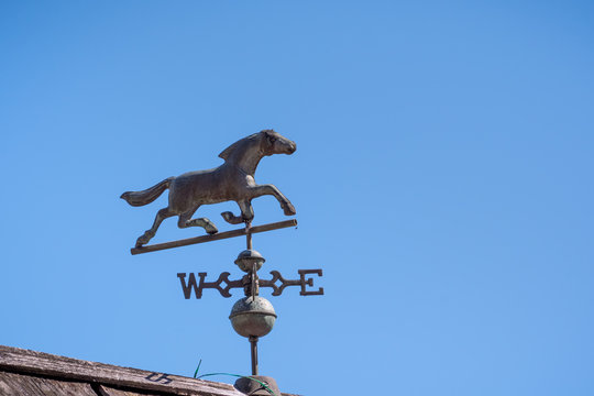 Weather vane on a blue sky background, Sausalito, California