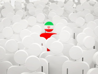 Man with flag of iran in a crowd