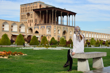 Iran, Ali Qapu Palace  is a grand palace in Isfahan on Naqsh-e Jahan Square in Isfahan (Esfahan). Tourist looking on the palace.