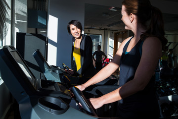 Friends working out together in gym