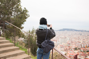 Woman Takes a Photo in Barcelona.
