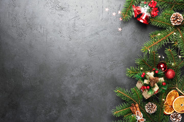 Christmas Background Fir Tree Decorations On Black Concrete With Copy Space
