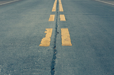 Asphalt highway with markings lines on road background (cross process)