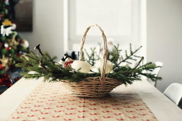 Fir branches in a large basket on the table at Christmas