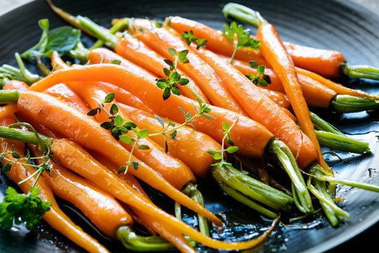 Roasted Baby Carrots with Herbs on Black Blate