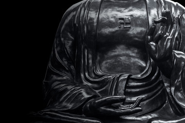 asian stone buddha statue in black with copy space for text art monotone.