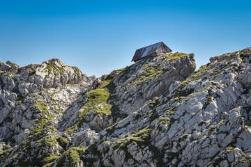 Old sheep barn on limestone rocks in the Julian Alps, Slovenia