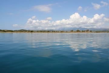 Beautiful blue mediterranean sea with clouds reflecting near Gialova, Greece