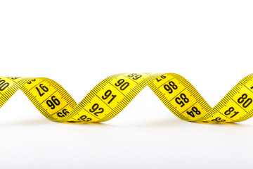 Measuring tape of the tailor for you design. On white background