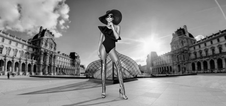 Elegant woman in a hat, bikini and sunglasses and amazing high heels shoes in  Paris France