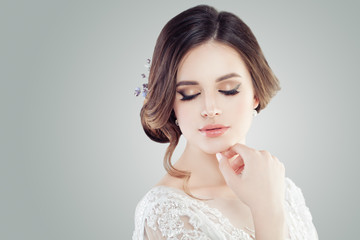 Cute young woman with closed eyes