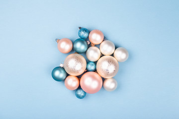Christmas composition made of Christmas balls on blue background. Minimal New year concept.