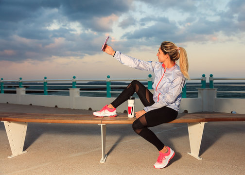 Young woman doing a selfie in sportswear after a running session
