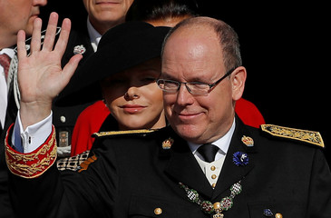 Prince Albert II of Monaco and his wife Princess Charlene leave after a mass at the cathedral during the celebrations marking Monaco's National Day in Monaco
