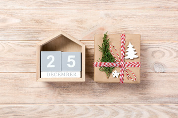 Calendar with date 25 december and gift boxes on color background. Christmas concept