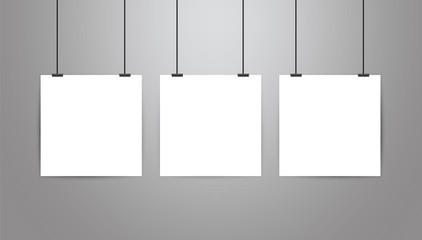Poster frame mockup stationary.Three vector realistic white blank square form paper poster on grey gradient background.Hanging on a rope with binder clip.Empty poster design template.White wall