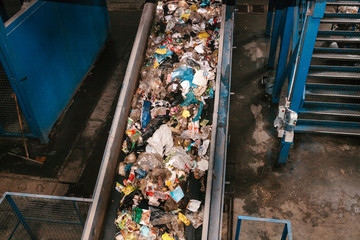 Waste sorting plant. Conveyor on which waste is moving to enter the sorting for further storage and disposal or recycling.