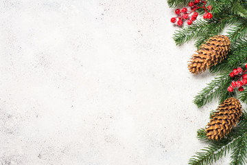 Christmas background with fir tree brunch and red decorations on