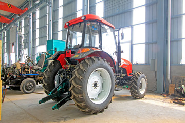 large tractor in storage workshop