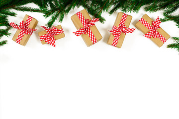 Christmas composition. Border made of gift, fir branches isolated on white background. Flat lay, top view, copy space
