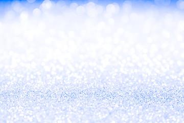 Blue glitter lights background.