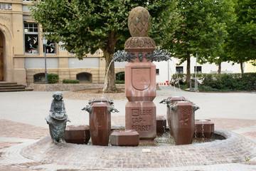 Artistic Gemeinde statue and fountain in public park at Sandhausen village in Heidelberg, Germany