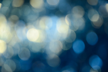 Bokeh photo. Holiday background. Christmas lights. background. Defocused sparkles. New Year backdrop. Festive wallpaper. Blinks. Carnival. Retro style photo.