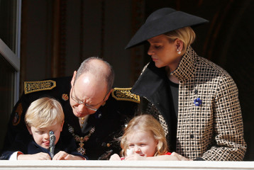 Prince Albert II of Monaco, his wife Princess Charlene and their children Prince Jacques and Princess Gabriella stand on the palace balcony during the celebrations marking Monaco's National Day in Monaco