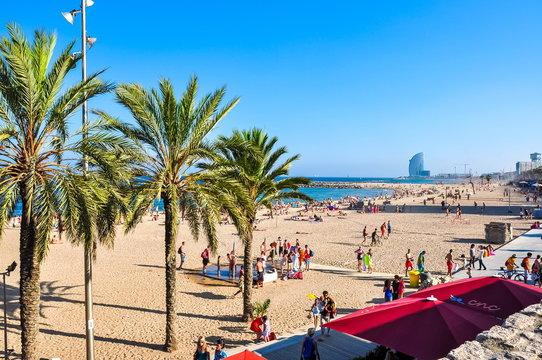 People on Barceloneta beach in summer evening, Barcelona, Spain
