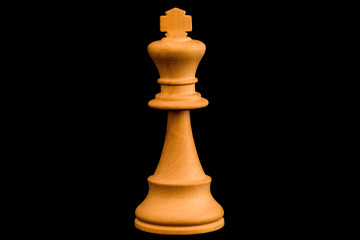 White King standard chess wooden piece on black background