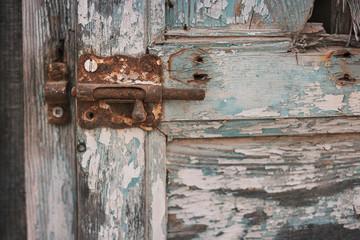 Rusty barrel bolt on shabby door