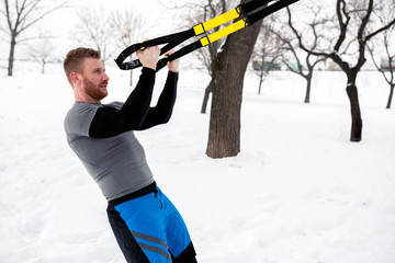 Biceps training exercises with suspension gear