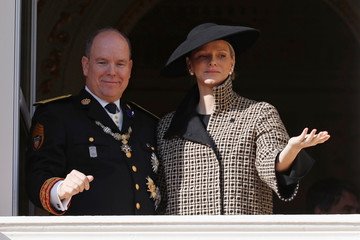 Prince Albert II of Monaco and his wife Princess Charlene wave from the palace balcony during the celebrations marking Monaco's National Day in Monaco
