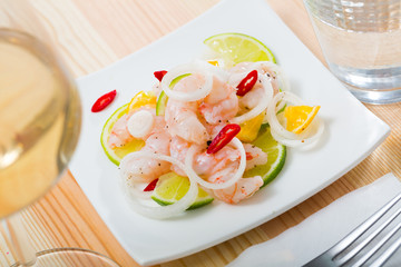Ceviche with shrimps, lime, tangerine and hot pepper