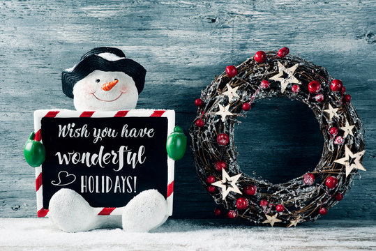 snowman and text wish you have wonderful holidays