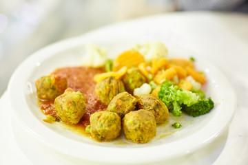 vegetable meatballs, steamed vegetables, mushroom soup. Vegetarian food, healthy food.
