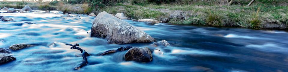 Mountain stream during autumn Wall mural