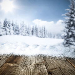 Table background with snow and frost