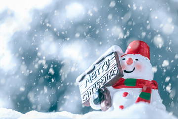 Merry Christmas and Happy New Year, Snowman with Snow Fall, happy greeting card and Christmas background concept.