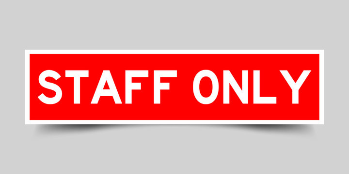 Square red sticker label in word staff only on gray background
