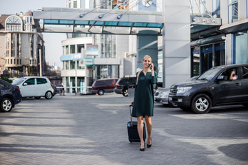 Business woman at international airport moving to terminal gate for airplane travel trip. Mobility concept and aerospace industry flight connections.