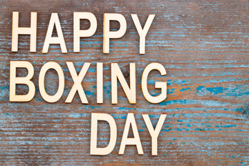 Text Happy Boxing Day word on wooden background